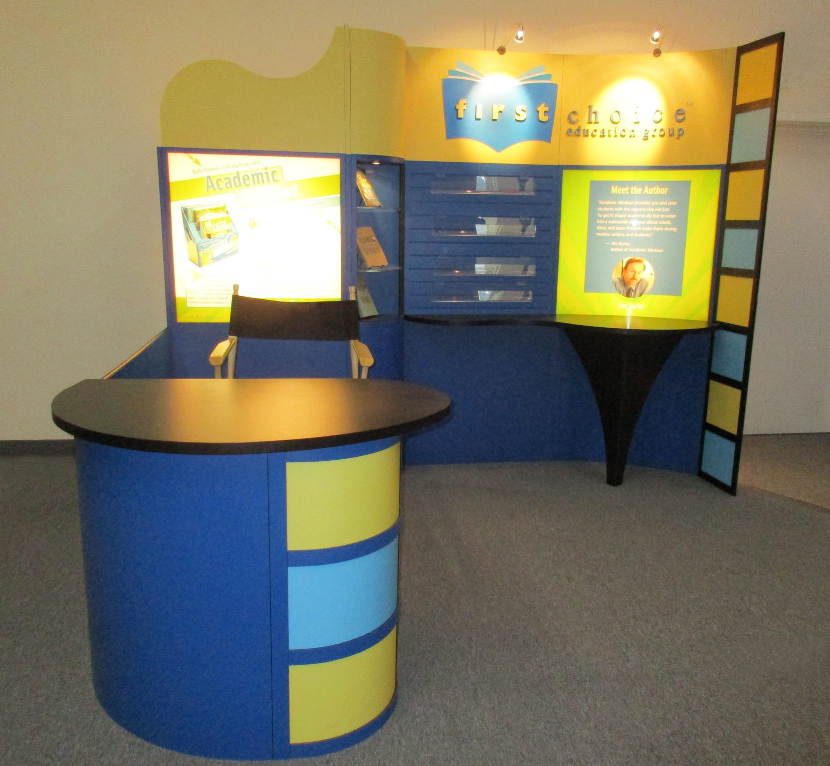 Pre-owned exhibits: 10x10 exhibit with shelves, curved counter and backlit graphics
