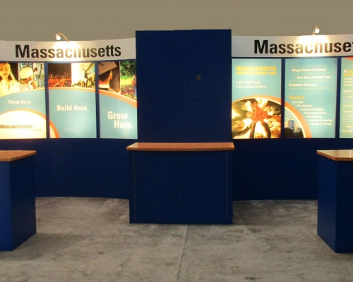 Pre-owned exhibits: 10x20 custom modular exhibit for sale with backlit graphics, monitor mount and three counters with storage