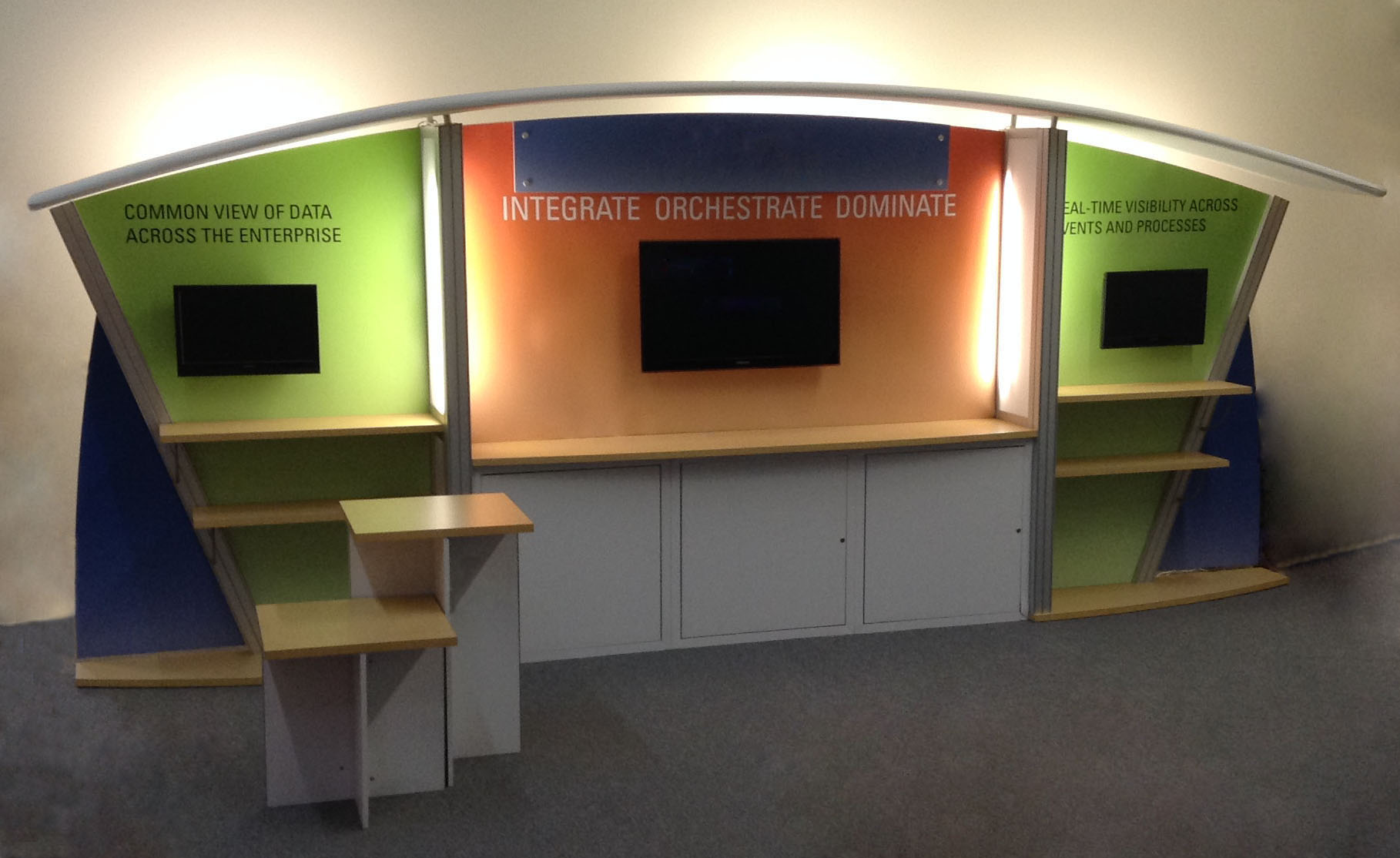 10x20 custom modular exhibit with storage, shelves, monitor mounts and counters