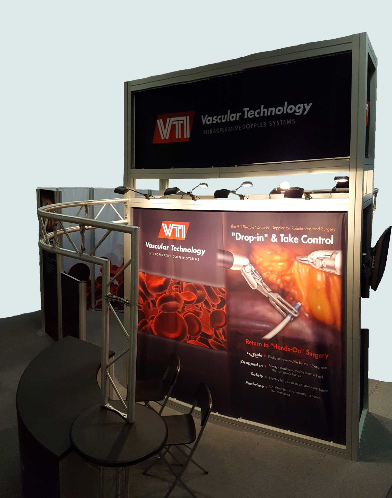 The trade show display is an island design, branded on all sides with dye-sub fabric graphics stretched between aluminum extrusions.