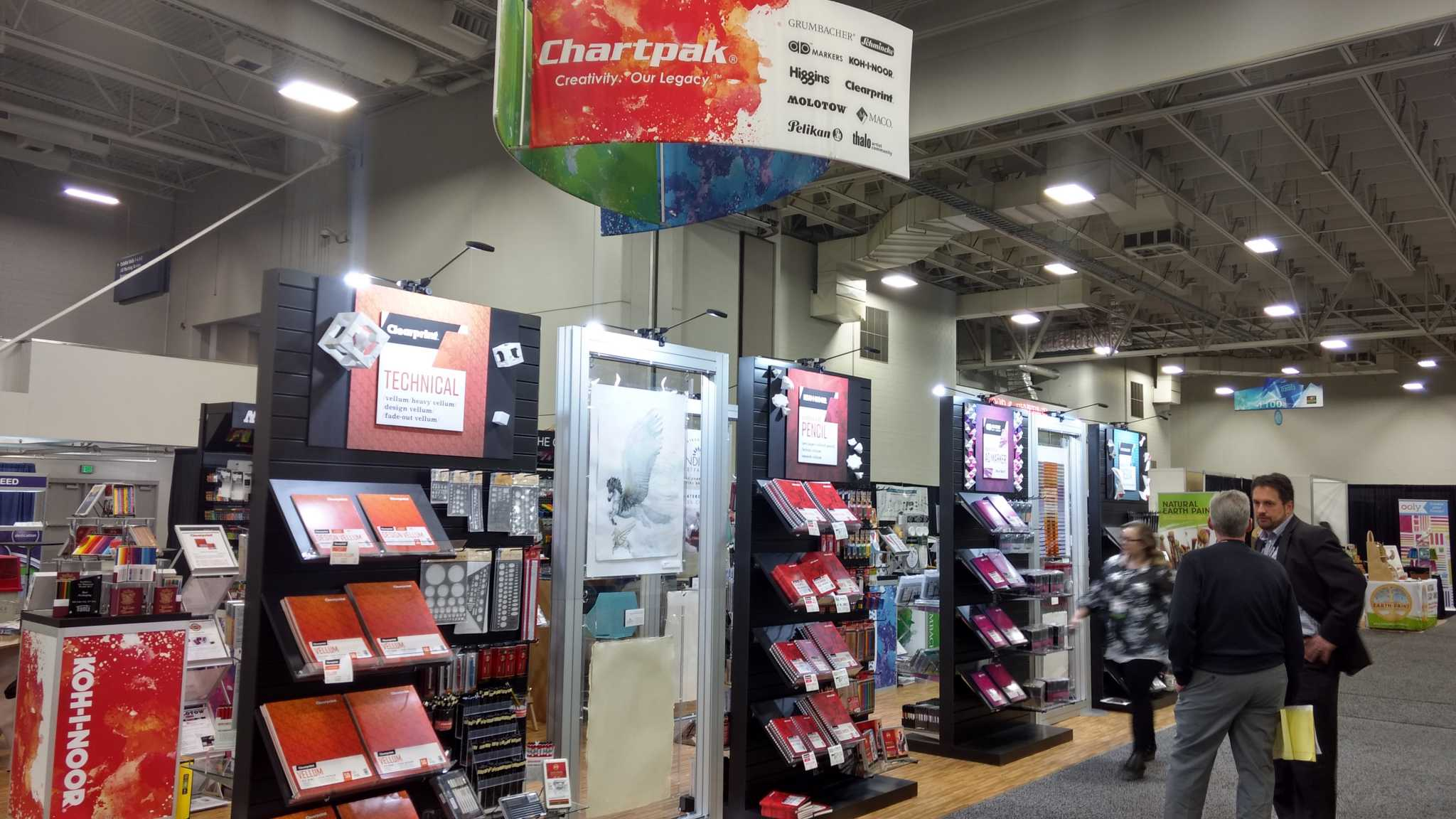 Chartpak island exhibit features custom slat walls to display products