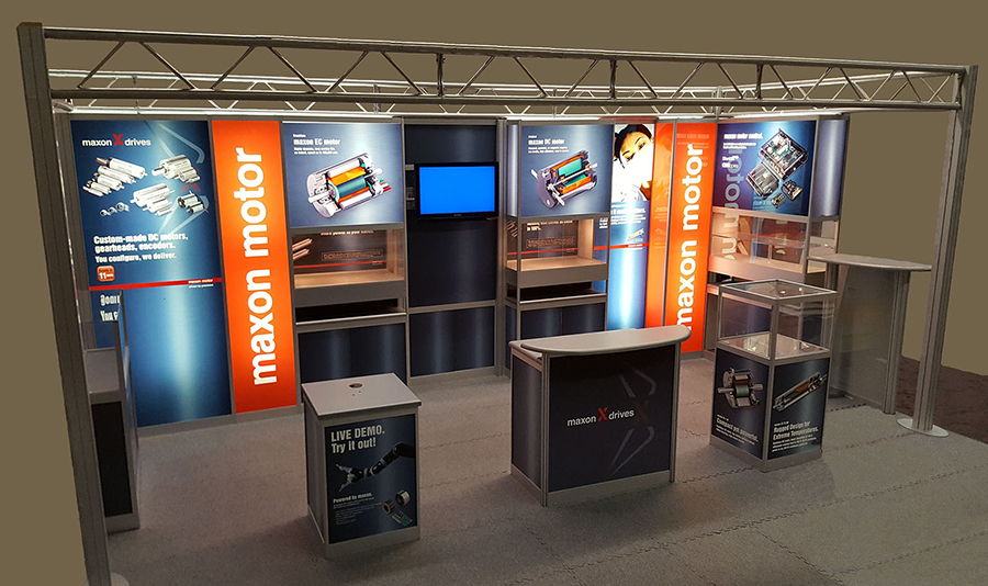 Maxon Motor custom modular exhibit has backlit graphics, counter, extrusions with graphic inserts and built-in display case