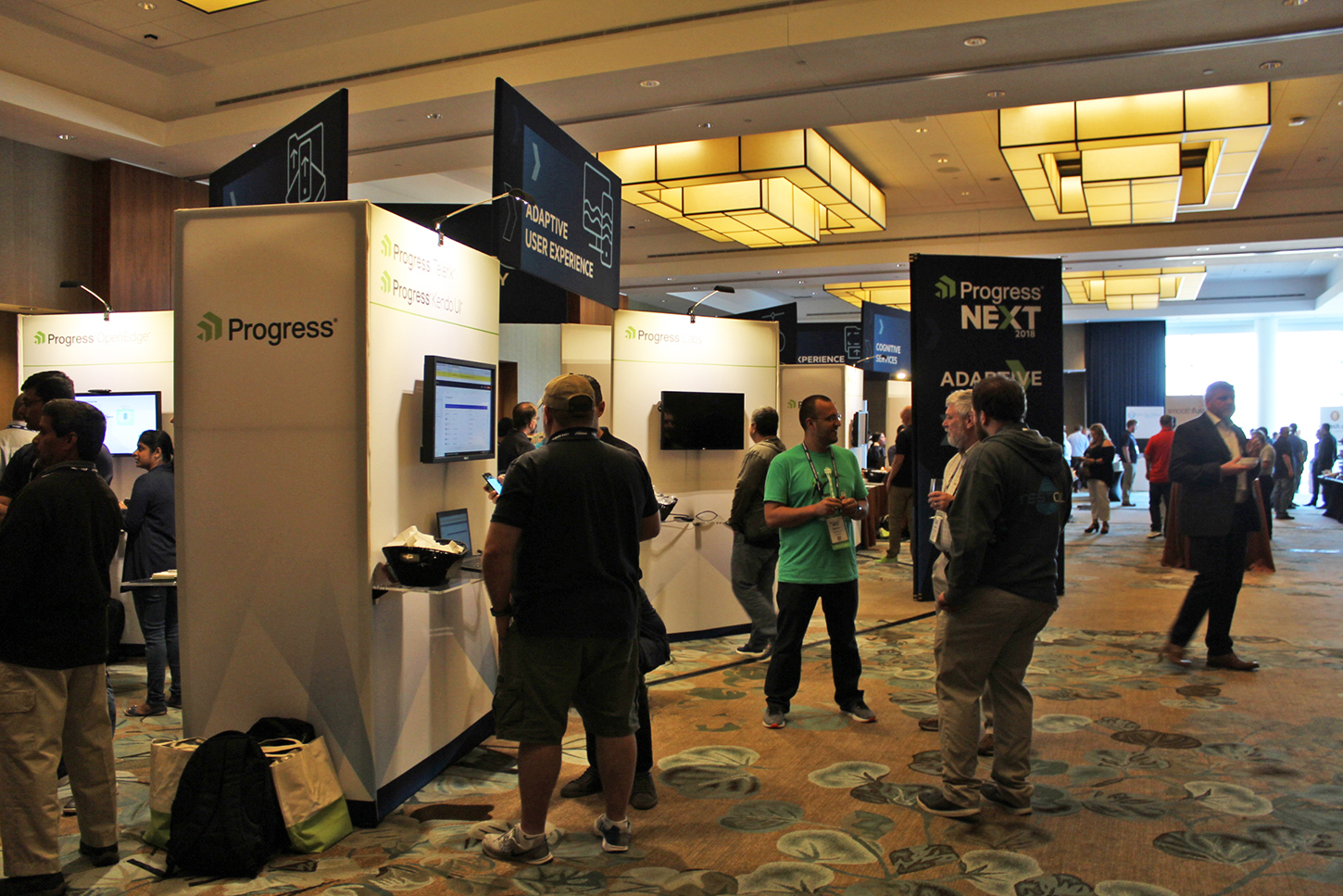 This 60' x 40' open concept custom exhibit combines branded fabric towers with LED lighting, wall-mounted monitors and shelving for laptops, and overhead signage to guide conference attendees through each interactive user experience.