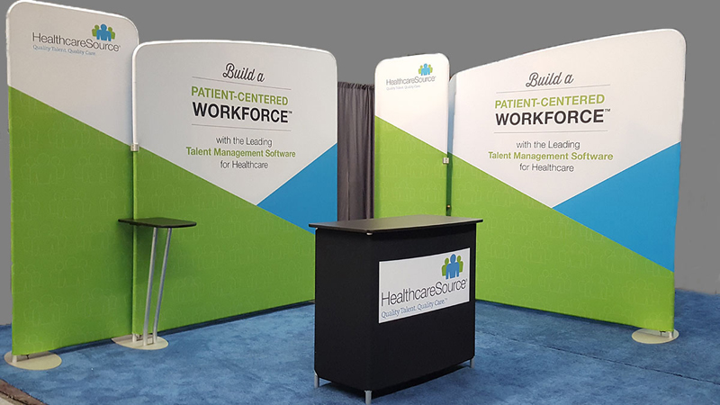 HealthcareSource's 10x20 tension fabric trade show display with counter can be reconfigured to fit any booth space