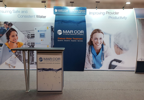 Mar Cor's 20' smartwall fabric display with vibrant graphics, lighting and reception counter with graphic insert