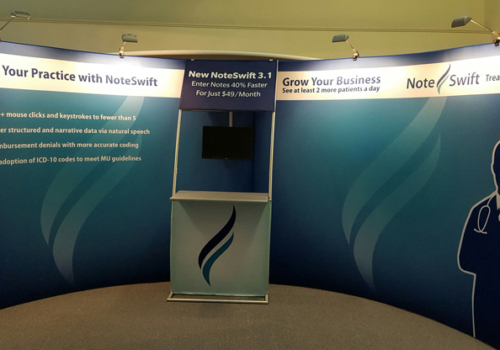 Noteswift's 10x20 portable display with graphics, lighting, counter with logo and monitor