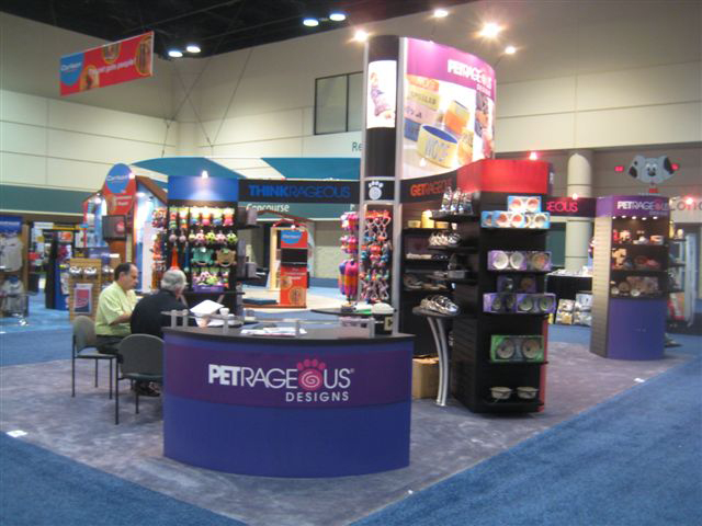 •PetRageous Designs' custom booth with black slatwall displays, counter and extrusion displays with graphic infills