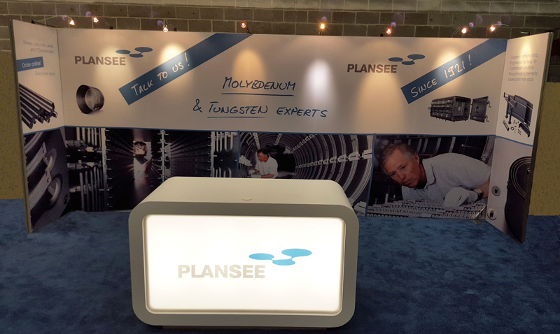 Plansee 20' portable back wall display with graphics, lighting and LED light box counter
