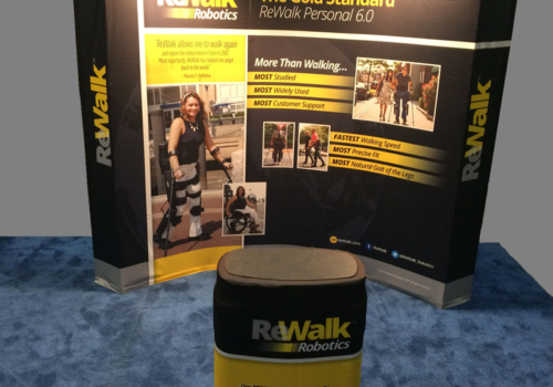 ReWalk Robotics' curved pop up display with lighting, fabric graphics and oval counter with wraparound graphic